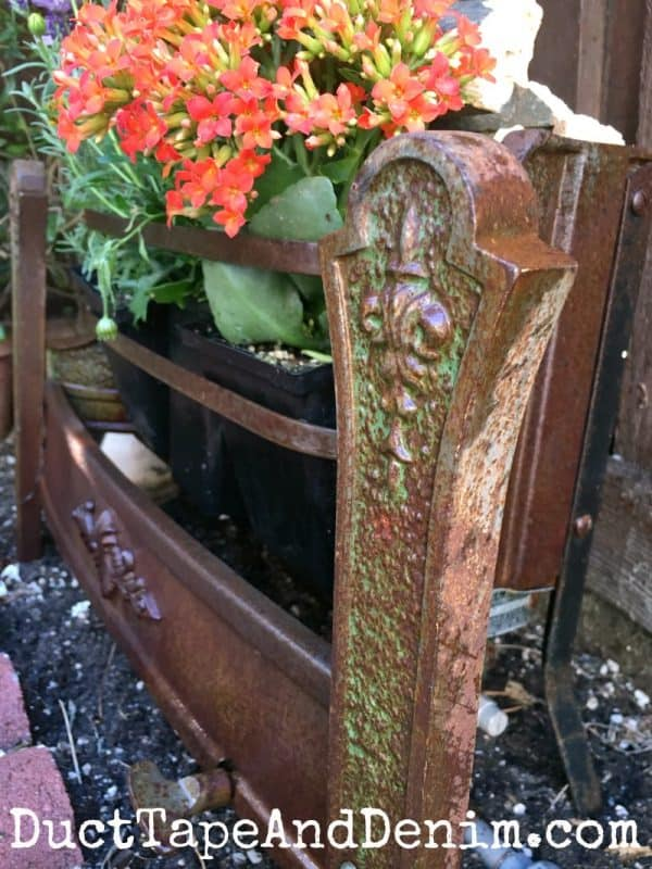 Detail on vintage heater planter, container gardening