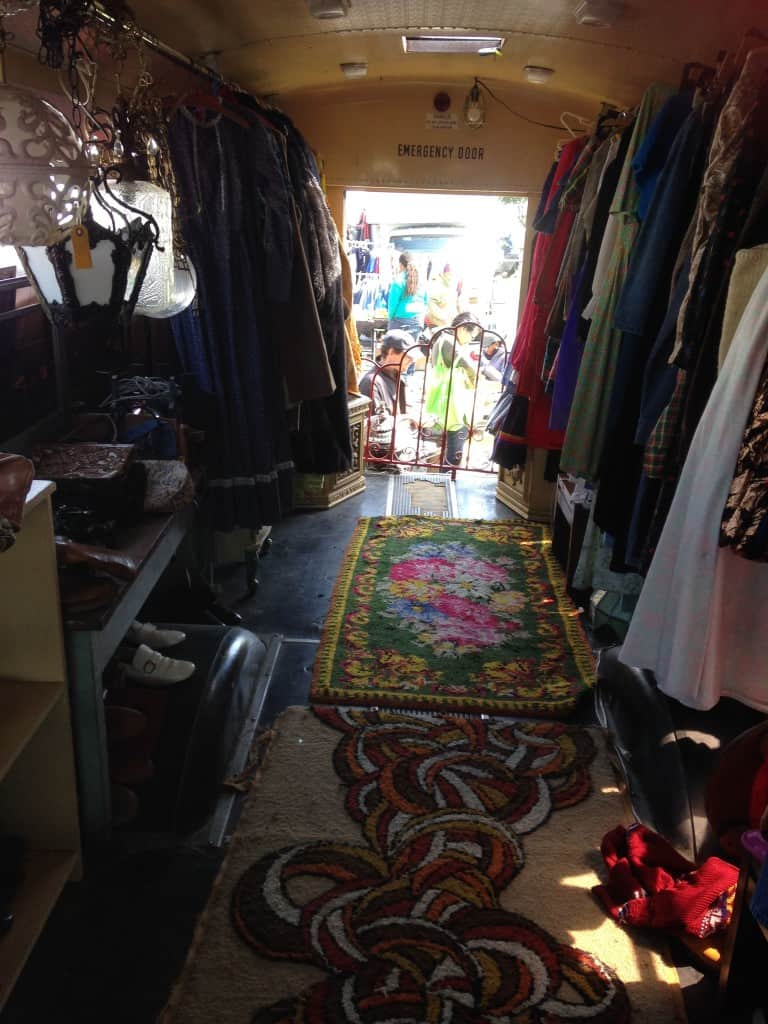 School bus filled with vintage clothes at Treasure Island Flea | DuctTapeAndDenim.com
