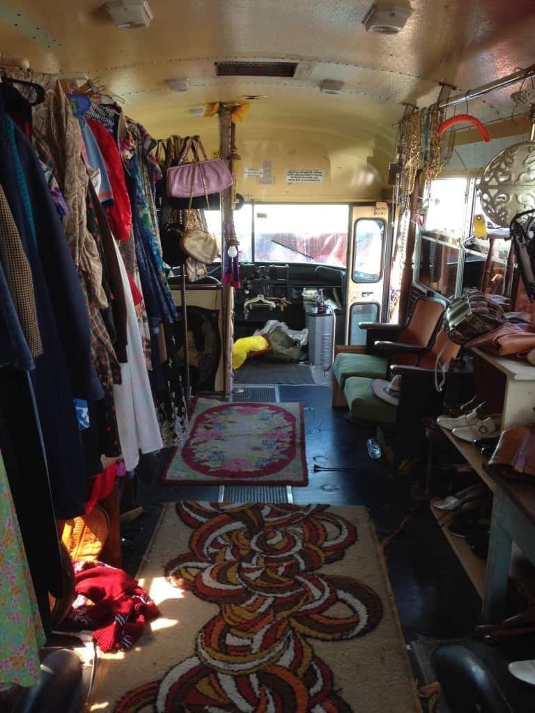 School bus filled with vintage clothes at Treasure Island Flea, front view | DuctTapeAndDenim.com