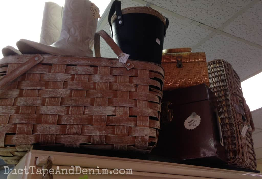 Painted picnic baskets and cowboy boots on top of my shelf at Room With a Past | DuctTapeAndDenim.com