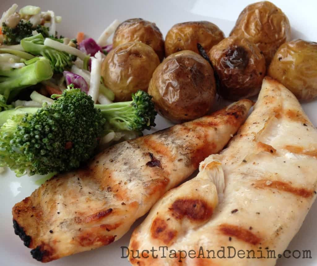 Roasted rosemary potatoes, grilled chicken, chopped vegetable salad | DuctTapeAndDenim.com