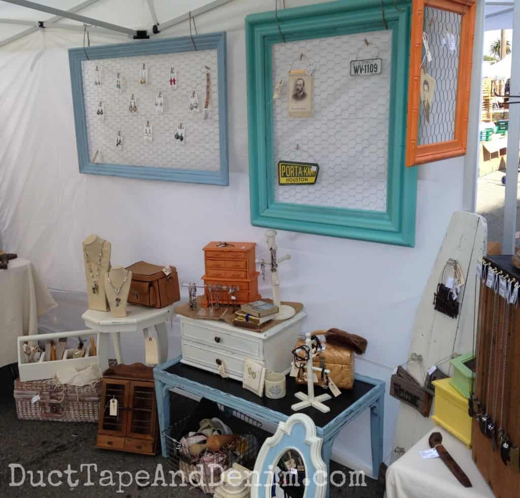 Side wall of my booth at Treasure Island Flea with the huge frames I painted with CeCe Caldwell's paints and added chicken wire to display earrings | DuctTapeAndDenim.com