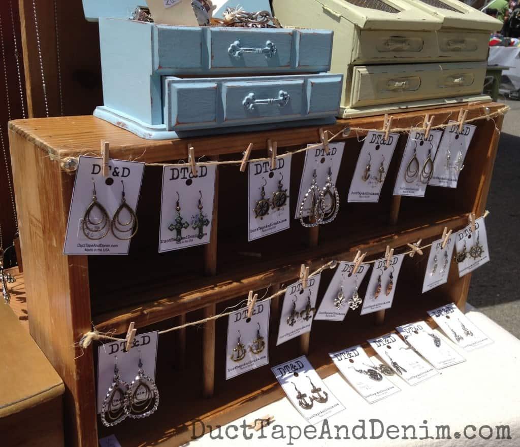 Vintage wine crate used as earring display at Treasure Island Flea | DuctTapeAndDenim.com