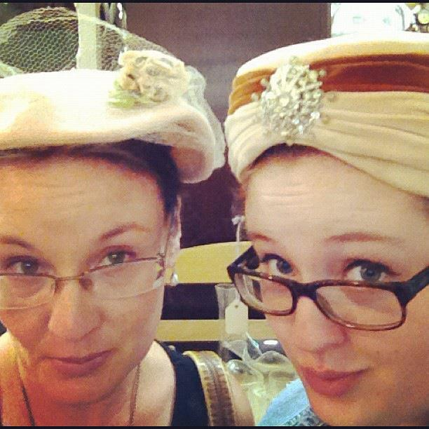 Jordy and I try on vintage hats at an antique shop in Glen Rose, Texas | DuctTapeAndDenim.com