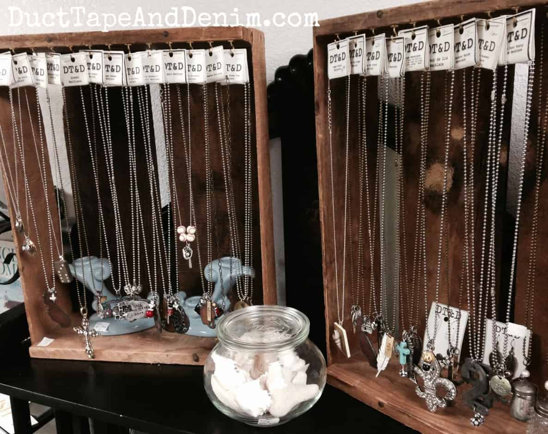 Vintage crate necklace display on my shelf at Paris Flea Market | DuctTapeAndDenim.com