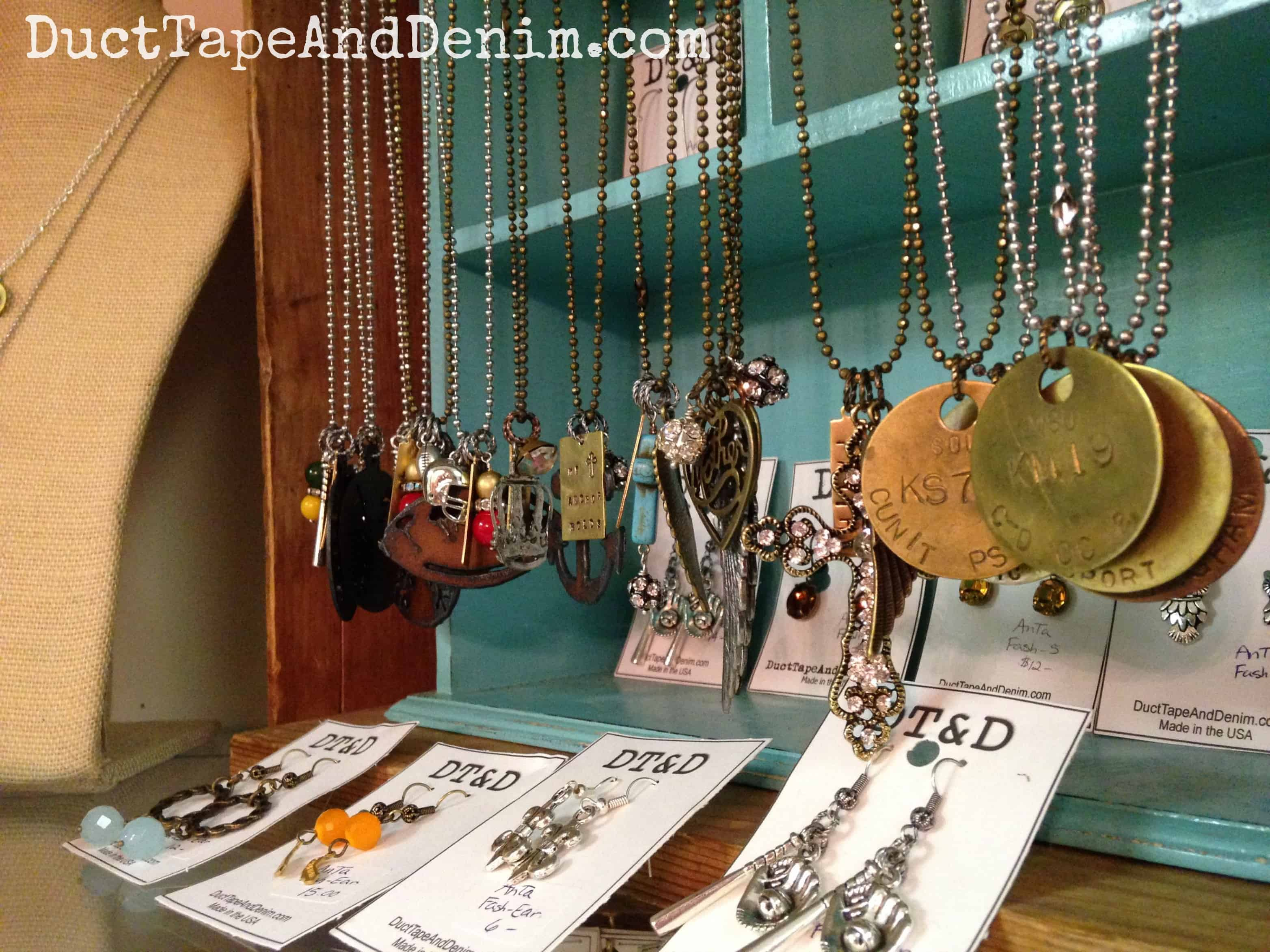 Close up of hand stamped and repurposed vintage jewelry displayed on my shelf at Room With a Past | DuctTapeAndDenim.com