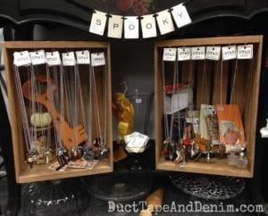 My bottom shelf at Paris Flea Market with lots of necklaces. | DuctTapeAndDenim.com