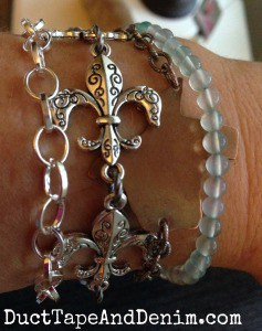 Arm party with fleur de lis and Texas bracelets | DuctTapeAndDenim.com