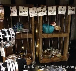 Christmas crates display necklaces on my shelf at Paris Flea Market | DuctTapeAndDenim.com