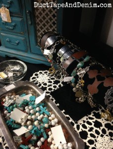 Lots of bracelets and painted jewelry cabinet on my shelf at Paris Flea Market | DuctTapeAndDenim.com