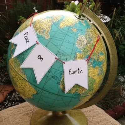 How to Make a Peace on Earth Holiday Garland for Your Globes