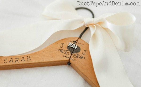 DIY Handstamped bridesmaid dress hanger from a wooden clothes hanger | DuctTapeAndDenim.com