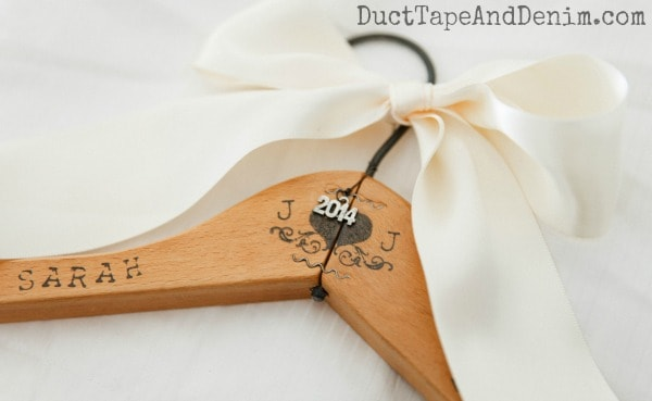 DIY Handstamped bridesmaid dress hanger from a wooden clothes hanger | DuctTapeAndDenim.com