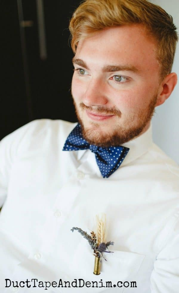 Groom wearing his lavender and wheat DIY boutonnieres, how to make boutonnieres with bullet casings | DuctTapeAndDenim.com