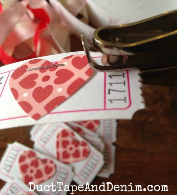 Punch holes in each corner of tickets for Valentine ticket garland | DuctTapeAndDenim.com