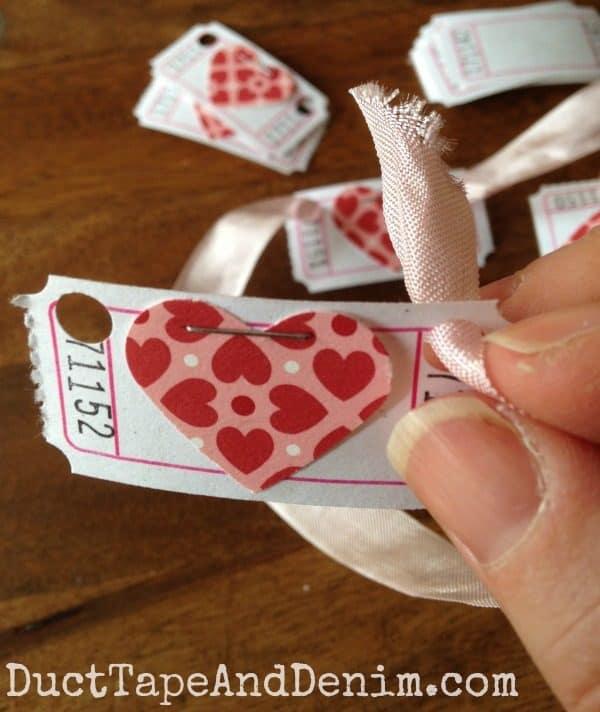 Run ribbon through tickets for my Valentine garland | DuctTapeAndDenim.com