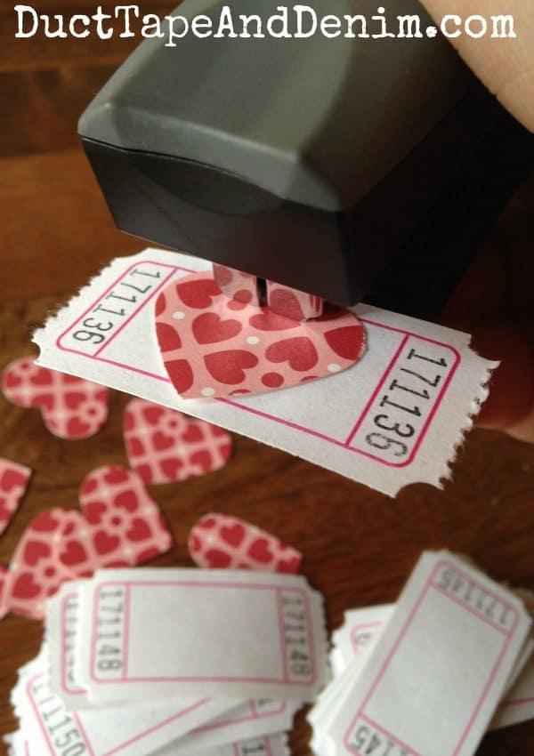 Staple hearts to tickets for my Valentine ticket garland | DuctTapeAndDenim.com