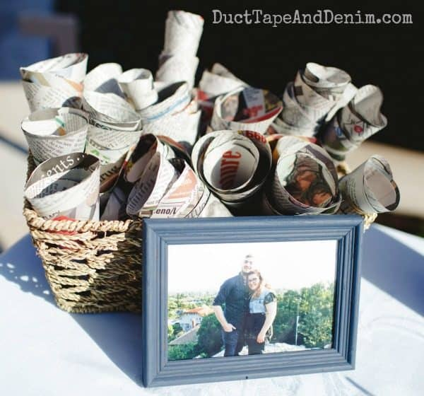 Empty newspaper cones wait to be filled with lavender at our summer wedding. DIY lavender toss cones on DuctTapeAndDenim.com
