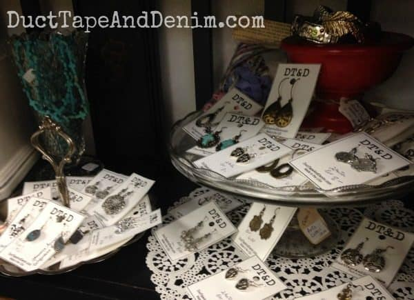 Using cake stands and candle sticks to give height on my shelf at Paris Flea Market, Livermore, California | DuctTapeAndDenim.com