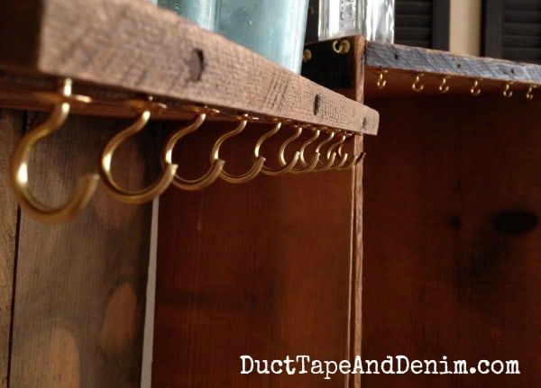 Close up of the cup hooks on my vintage crate necklace display | DuctTapeAndDenim.com