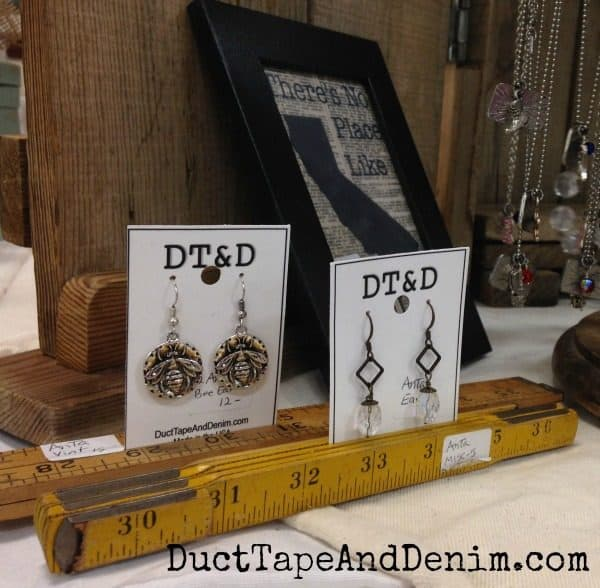 Earrings displayed in vintage wooden rulers at Roses and Rust Vintage Market | DuctTapeAndDenim.com