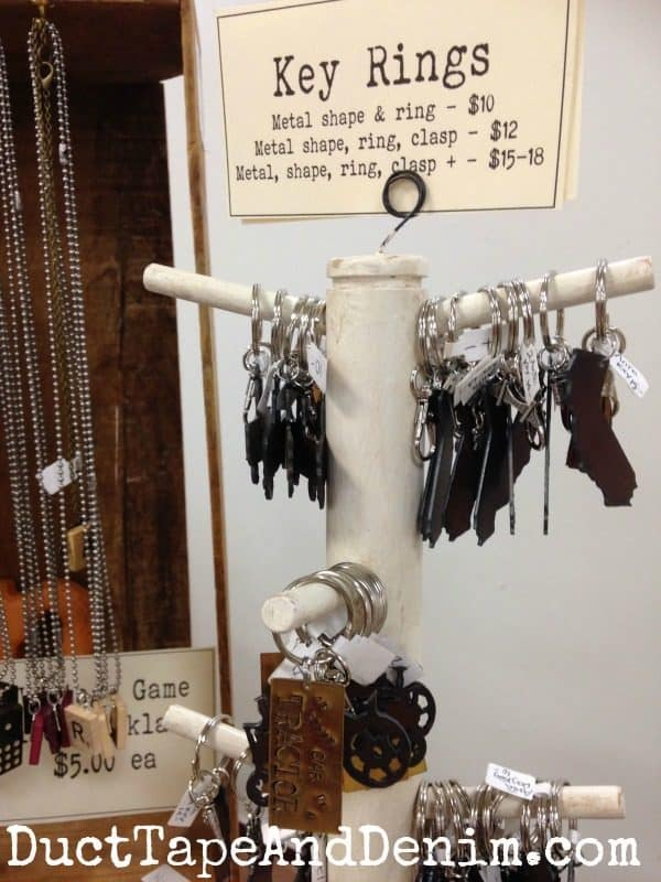 Key rings displayed on an old mug rack at Roses and Rust Vintage Market | DuctTapeAndDenim.com