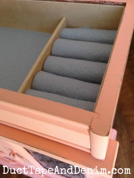 Close up of the inside of my jewelry cabinet makeover. Covered the stained felt with new. | DuctTapeAndDenim.com