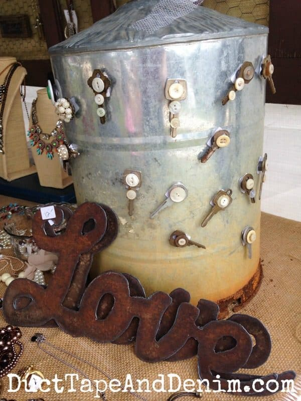 Rusty LOVE and chicken waterer displaying my vintage key and button magnets at Antique Alley | DuctTapeAndDenim.com