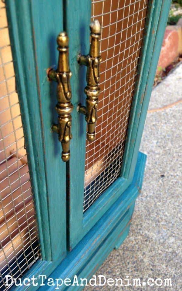 Close up of the Thomasville Teal jewelry cabinet