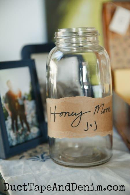 Honeymoon jar on the wedding gift table   DuctTapeAndDenim.com