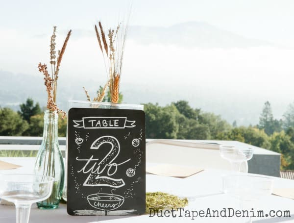 Table 2 wedding centerpieces with dried flowers and chalkboard sign | DuctTapeAndDenim.com