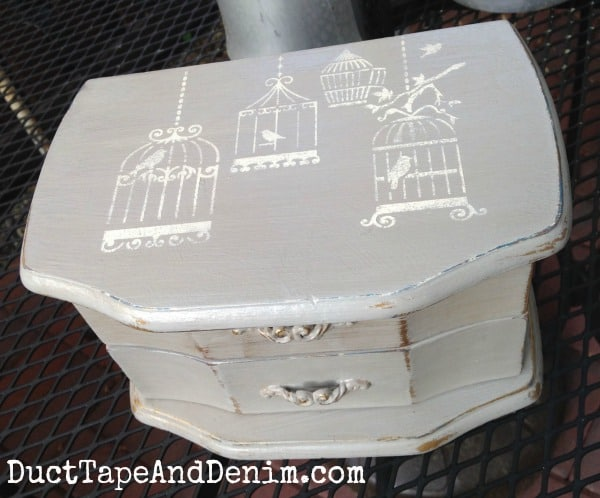 Top of jewelry box. Painted with CeCe Caldwell's Seattle Mist, stenciled in Vintage White. | DuctTapeAndDenim.com