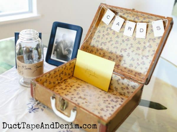 Vintage wedding box for cards from an old suitcase and CARD banner on wedding gift table | DuctTapeAndDenim.com