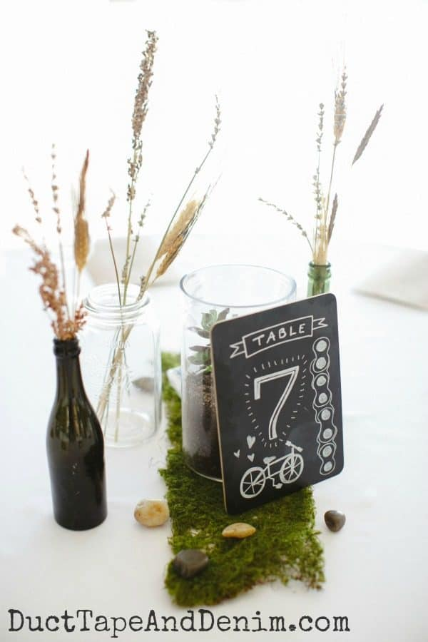 Wedding centerpiece on Table 7 with dried flowers and chalkboard sign | DuctTapeAndDenim.com