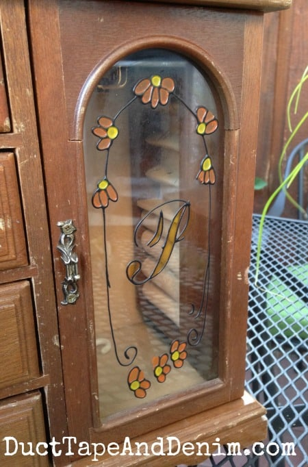 BEFORE - Faux stained glass on an old jewelry cabinet. Jewelry cabinet makeover.   DuctTapeAndDenim.com
