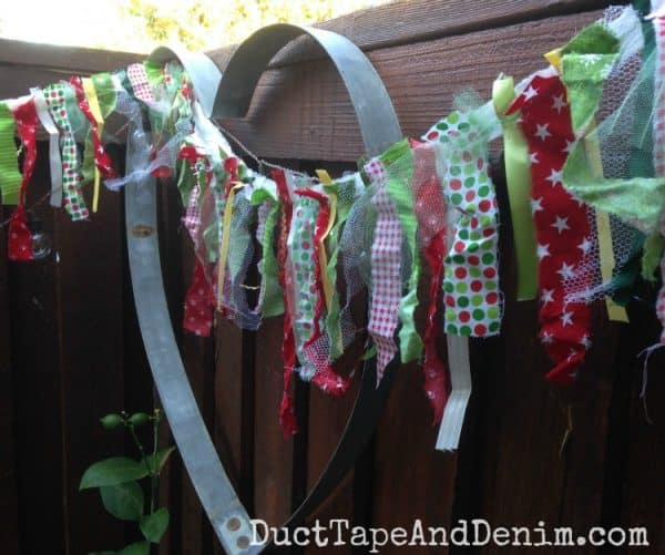 Scrap fabric Christmas garland made with scraps of fabric, lace, tulle, seam binding, and ribbons | DuctTapeAndDenim.com