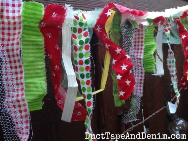 Close up of the fabric scrap Christmas garland I sewed. Details on DuctTapeAndDenim.com