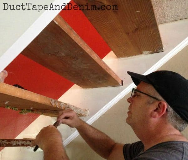 Hubby pulls the staples out of our stairs. See how they turned out on DuctTapeAndDenim.com