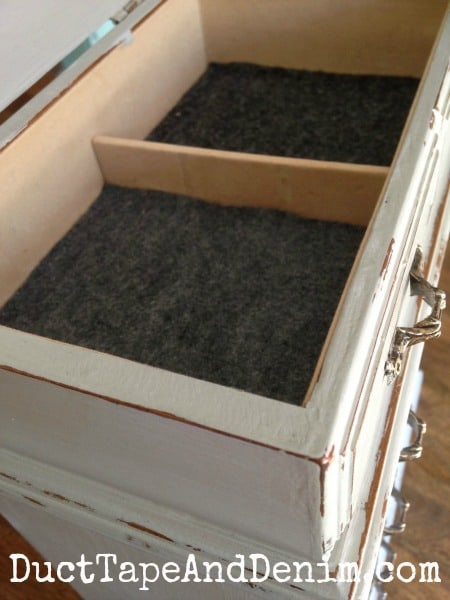 New felt on the inside of the old jewelry cabinet I bought at the thrift store.   DuctTapeAndDenim.com