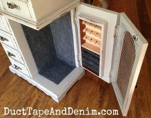 Unique jewelry cabinet with folding door on the old jewelry cabinet makeover   DuctTapeAndDenim.com