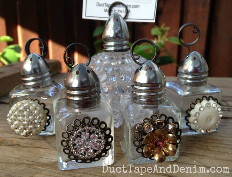 Vintage salt shakers repurposed as photo holders