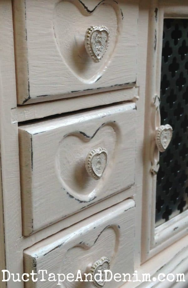 Love the heart shapes on the drawers of this old jewelry cabinet | DuctTapeAndDenim.com