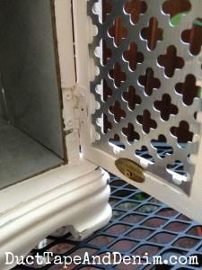 Metal insert in the door of my thrift store makeover jewelry cabinet | DuctTapeAndDenim.com