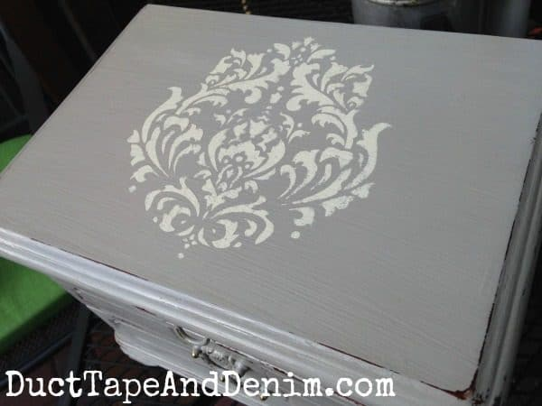 Top of vintage jewelry box painted with CeCe Caldwell's Seattle Mist and stenciled with Vintage White. | DuctTapeAndDenim.com