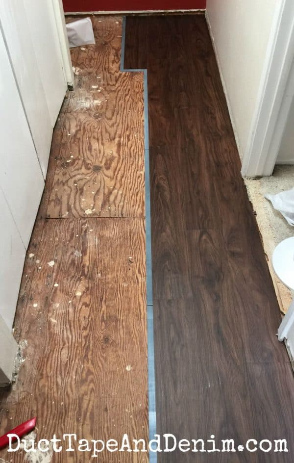 Halfway done with the Allure plank flooring in our hall | DuctTapeAndDenim.com