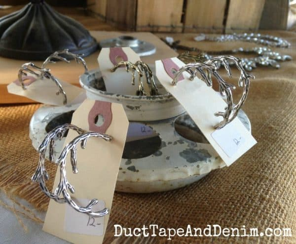 Antler earrings displayed in a chick feeder at the flea market | DuctTapeAndDenim.com
