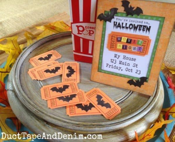 Halloween movie night centerpiece with popcorn box and bat tickets | DuctTapeAndDenim.com