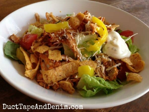 Buffalo chicken salad with cheese, peppers, and Fritos in our Day After the Big Game salad made with leftovers from our football party | DuctTapeAndDenim.com