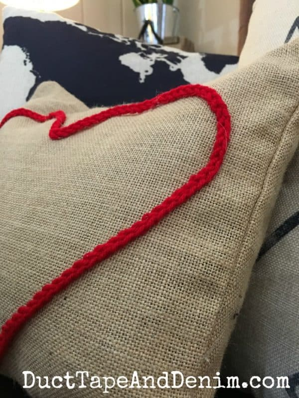 Close up of my red crocheted canvas Valentine pillow | DuctTapeAndDenim.com
