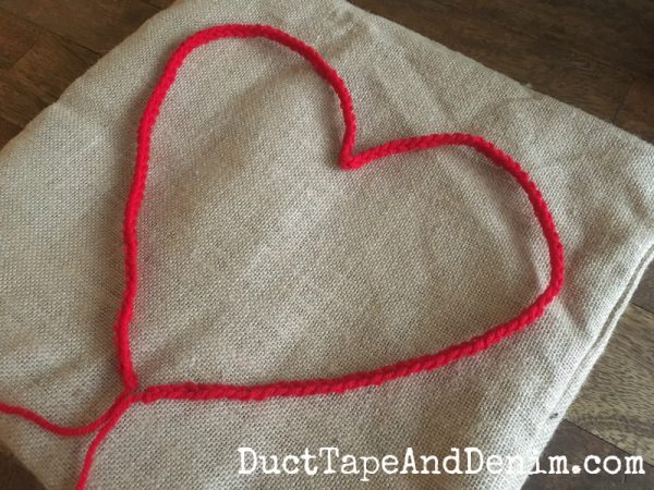 Red crocheted heart on canvas Valentine pillow ~ 15-minute Valentine's Day craft ~ DuctTapeAndDenim.com